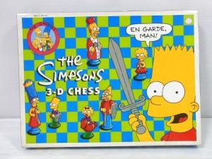 the SIMPSONS 3-D CHESSの箱画像。ロゴや、キャラクターのイラストが描かれている。