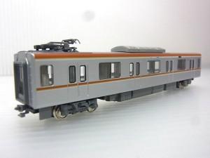 KATO 10-866 東京メトロ 1000系 有楽町線・副都心線 6両基本セットの車体画像。車体にカラーのラインが見えている。